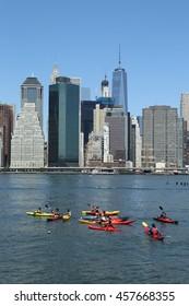 BROOKLYN, NEW YORK - JULY 19, 2016: Kayaks in Hudson River and Manhattan skyline panorama from Brooklyn Bridge Park