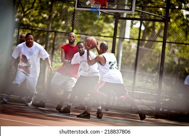 BROOKLYN, NEW YORK - JULY 2, 2011: Street basketball players on the basketball court on July 2, 2011, Brooklyn, USA