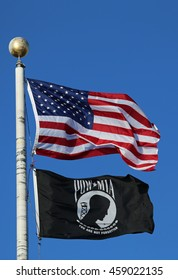 BROOKLYN, NEW YORK - JULY 26, 2016 : American and POW/ MIA flags in Brooklyn. The POW/MIA flag is a symbol of US military personnel taken as prisoners of war or listed as missing in action