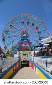 BROOKLYN, NEW YORK - JUNE 15: Wonder Wheel at the Coney Island amusement park on June 15, 2014. Deno's Wonder Wheel a hundred and fifty foot eccentric Ferris wheel. This wheel was built in 1920