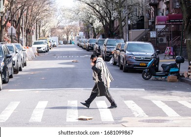 BROOKLYN, NEW YORK - MARCH 21: A hasidic Satmar Jew is seen walking to Sabbath Prayers as the coronavirus continues to spread across the United States on March 21, 2020 in Williamsburg, Brooklyn, NY.
