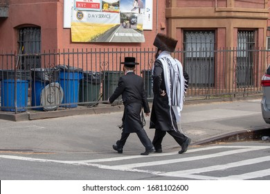 BROOKLYN, NEW YORK - MARCH 21: Hasidic Satmar Jewish father and son are seen walking to Sabbath Prayers on March 21, 2020 in Williamsburg neighborhood of Brooklyn.