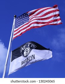 BROOKLYN, NEW YORK - MARCH 3: Brooklyn Nets and American flags flying in front of  Barclays center on March 3, 2013.Barclays Center with 18,000 seats serves as the new home of the NBAs Brooklyn Nets.