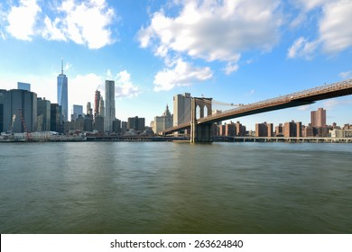BROOKLYN, NEW YORK - MARCH 8, 2015: New York City Skyline and the Brooklyn Bridge from Brooklyn Heights.
