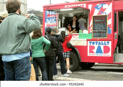 BROOKLYN, NEW YORK, MAY 22: Customers line up to purchase food from a food truck in Grand Army Plaza on May 22, 2011. Food trucks are a popular new source for fast, inexpensive, yet creative food.