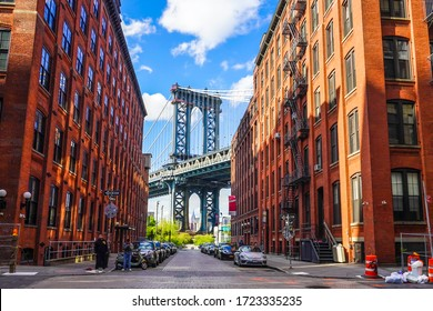 BROOKLYN, NEW YORK - MAY 4, 2020: Iconic Manhattan Bridge and Empire State Building view from Washington Street in Brooklyn, New York