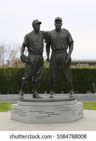 BROOKLYN, NEW YORK - MAY 5, 2018: Jackie Robinson and Pee Wee Reese Statue in front of MCU ballpark in Brooklyn