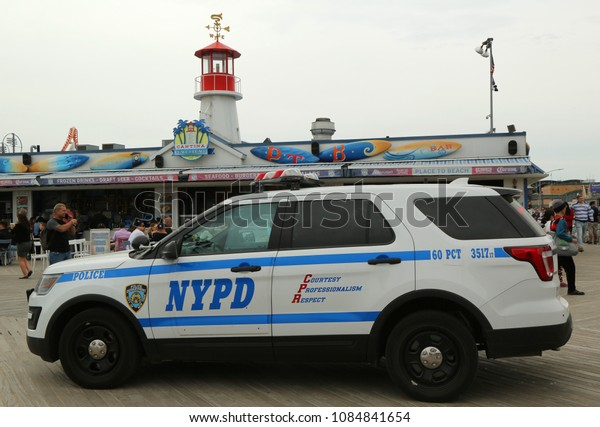 BROOKLYN, NEW YORK - MAY 5, 2018: NYPD vehicle provides security at Coney Island Boardwalk in Brooklyn.The New York Police Department, established in 1845, is the largest police force in USA