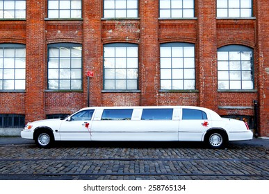 Brooklyn, New York, NY USA - October 26, 2013: White Limousine: White limousine Lincoln Town Car at street in Brooklyn.