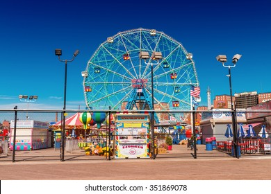 BROOKLYN, NEW YORK - OCT 20: Coney Island Boardwalk with Wonder Wheel on October 20, 2015 at Coney Island, NY The boardwalk, built in 1923, stretches for 2 51 miles.