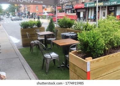 Brooklyn, New York / United States - July 11 2020: Restaurant outdoor seating on city street during Coronavirus pandemic shutdown