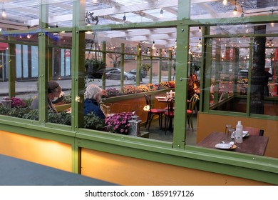 Brooklyn, New York / US - November 21 2020: Outdoor dining structures in the Fort Greene neighborhood of Brooklyn. Restaurants have felt the affects of the coronavirus pandemic acutely.