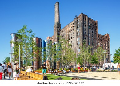Brooklyn, New York / USA - 07 08 2018: Domino Park in Brooklyn, Williamsburg, Old sugar factory,