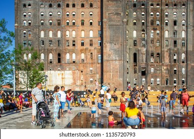 Brooklyn, New York / USA - 07 08 2018: Domino Park in Brooklyn, Williamsburg, Old sugar factory,