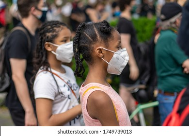 Brooklyn, New York / USA - June 4, 2020: Protesters and Families, Parents with Children, Kids, Babies Protesting and Marching with Signs and Posters with Masks