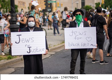 Brooklyn, New York / USA - June 4, 2020: Jews Jewish People From Hasidic Community Supporting and Protesting For Black Lives Matter George Floyd Movement During Coronavirus Covid-19 Pandemic with Mask