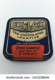 Brooklyn, New York / U.S.A. - May 9, 2019: Vintage Ex-Lax chocolated  laxative tin cans from the 1940s and 1950s. These lithograph tin cans feature mid-century advertising in the United States.