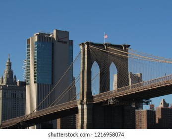 Brooklyn, New York/United States of America - October 30, 2018: picture of the Brooklyn Bridge, with the Verizon Building in the background.