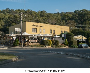 Brooklyn NSW Australia May 19th 2019 Anglers Rest Hotel Facade Sunday autumn afternoon and Customers outdoor area enjoying the good weather and big trees background blur