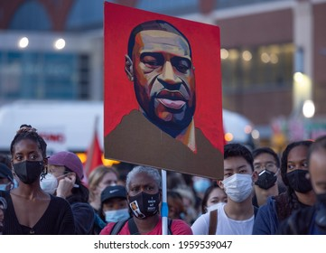 BROOKLYN, N.Y. – April 20, 2021: Demonstrators gather outside the Barclays Center after former Minneapolis police officer Derek Chauvin was convicted of murder in the May 2020 death of George Floyd.