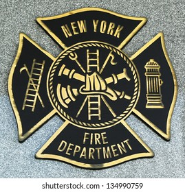 BROOKLYN, NY - APRIL 4: FDNY emblem on fallen officers memorial on April 4, 2013 in Brooklyn, NY. 343 firefighters were killed when World Trade Center buildings collapsed on September 11, 2001