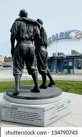 BROOKLYN, NY - APRIL 9: Jackie Robinson and Pee Wee Reese Statue in Brooklyn in front of MCU ballpark on April 9, 2013. 42 is an upcoming 2013 Hollywood film about baseball player Jackie Robinson