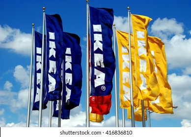 Brooklyn, NY - August 13, 2007:  IKEA flags fly from metal poles at the entrance to the Red Hook Brooklyn IKEA superstore