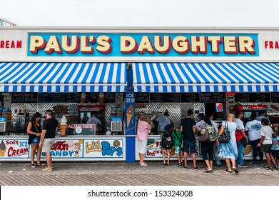 BROOKLYN, NY - AUGUST 23: Coney Island landmark food concession on boardwalk in Brooklyn, NYC on August 23, 2013. Known as Papa Burger atop of Paul's Daughter Clam bar is a Coney Island icon.