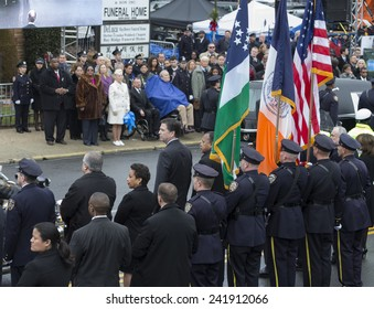 Brooklyn, NY - January 04, 2015: FBI Director James Comey & Loretta Lynch nominee for Attorney General attend ceremony at Aievoli Funeral Home for the funeral of slain NYC Police Officer Wenjian Liu