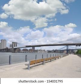 BROOKLYN, NY - JUL 14: Waterfront Brooklyn Bridge Park promenade has views of Brooklyn Bridge, Manhattan Bridge and Skyline and hosts more than 400 free events annually. Brooklyn Jul 14, 2013.