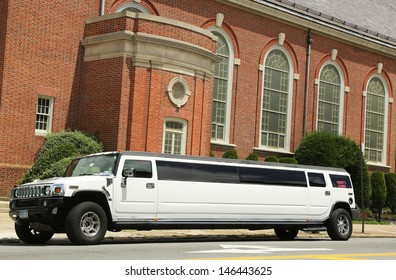 BROOKLYN, NY - JULY 14: Stretch limousine in front of the church in Brooklyn on July 14, 2013. The first stretch limousine was created in Fort Smith, AR around 1928 by a coach company named Armbruster