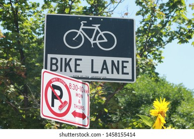 Brooklyn NY July 19 2019 Bike Lane Street sign and sweeping rules in ther crown heights section of brooklyn on a sunny summer day