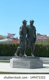 BROOKLYN, NY - JULY 30: Jackie Robinson and Pee Wee Reese Statue in Brooklyn in front of MCU ballpark on July 30, 2013. 42 is an upcoming 2013 Hollywood film about baseball player Jackie Robinson