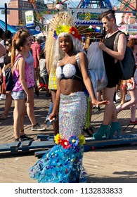 BROOKLYN, NY - June 16, 2018: A woman in a mermaid costume poses during the 36th Annual Coney Island Mermaid Parade. The parade marks New York's start of the summer season.