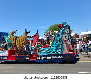 BROOKLYN, NY - June 16, 2018:  A colorful float passes by during the 36th Coney Island Mermaid Parade. The parade marks New York's start of the summer season.