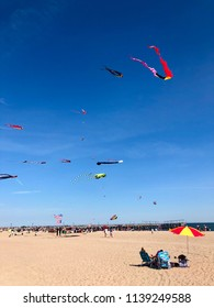 BROOKLYN, NY - June 16, 2018: Colorful kites fly over the beach in Coney Island Beach, Brooklyn.