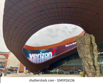 BROOKLYN, NY - MARCH 12, 2018: Up view of the exterior structure of Barclays Center multipurpose arena on a cloudy day. Barclays hosts concerts, boxing, basketball and entertainment events.