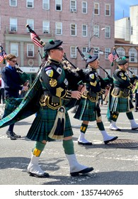 BROOKLYN, NY - March 24, 2019: Bagpipe players march in the 26th annual  Bay Ridge St. Patrick's Day Parade in loving memory of sweet Sally Sunshine.