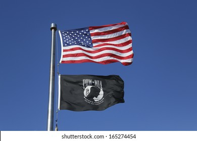 BROOKLYN, NY - OCTOBER 20 : American and POW/ MIA flags in Brooklyn on October 20, 2013. The POW/MIA flag is a symbol of US military personnel taken as prisoners of war or listed as missing in action