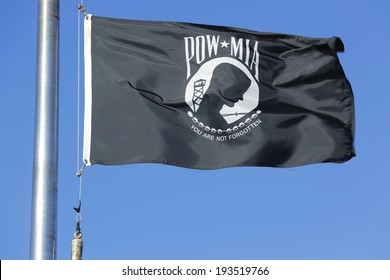 BROOKLYN, NY - OCTOBER 20: POW/ MIA flag in Brooklyn on October 20, 2013. The POW/MIA flag is a symbol of US military personnel taken as prisoners of war or listed as missing in action
