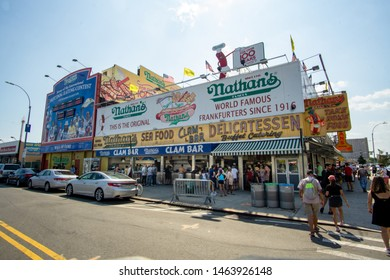 Brooklyn, NY / United States - July 28, 2019: Coney Island's famous Nathan's Hotdogs. The original Nathan's restaurant stands at the corner of Surf and Stillwell Avenues in the Coney Island.