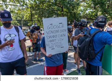 Brooklyn, NY, USA - August 1, 2020: They can't Burn Us All - unity rally against hate crime and racism at Seth Low Park after an 89 year old Asian woman was a victim of a hate crime in Bensonhurst