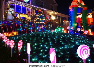 Brooklyn, NY, USA - December 24, 2015: Snow-covered decorations at Dyker Heights - a neighborhood in Brooklyn known for its extravagant displays every Christmas.