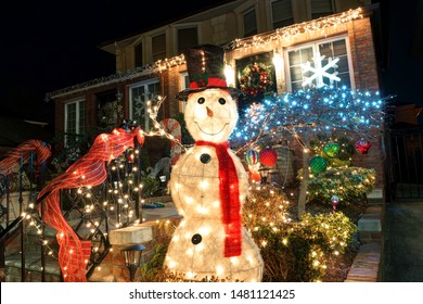 Brooklyn, NY, USA - December 26, 2016: Snow-covered decorations at Dyker Heights - a neighborhood in Brooklyn known for its extravagant displays every Christmas.