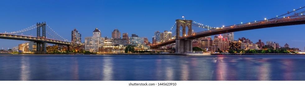 Brooklyn, NY, USA - June 01, 2017: Evening panoramic view of Brooklyn Riverfront between the Manhattan Bridge and the Brooklyn Bridge (Main Street Park and Brooklyn Bridge Park). New York City