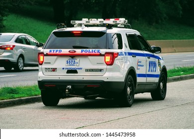 Brooklyn, NY / USA - June 29, 2019 : NYPD Highway Patrol Stopping Cars on the Belt Parkway