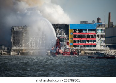 BROOKLYN, NY/USA - JANUARY 31 2015: The FDNY's fireboat Fire Fighter II pumps a stream of water onto the massive warehouse fire on the Williamsburg, Brooklyn waterfront.