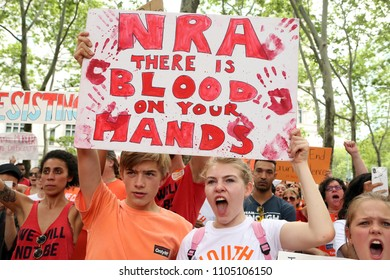 "Brooklyn, NY/USA - June 2, 2018: Thousands of youth gun control activists marched over New York's iconic Brooklyn Bridge on Saturday for the ""Youth over Guns"" march to protest gun violence."