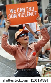 """Brooklyn, NY/USA - June 2, 2018: Thousands of gun control activists marched over New York's iconic Brooklyn Bridge on Saturday for the """"Youth over Guns"""" march to protest gun violence."""