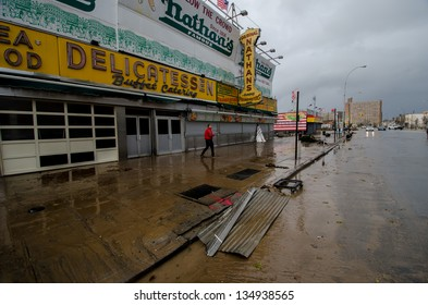 BROOKLYN, NY/USA - OCTOBER 30: A man walks in front of Nathan's Famous hot dog stand amid damage from hurricane Sandy on October 30, 2012 in the Coney Island section of Brooklyn.